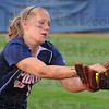 Foul out: Patriot Hailee Travioli gloves a foul tip for an out against West Vigo on the Terre Haute North diamond Thursday evening.