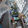 Come and see: Union Hospital opened up its lower level to several businesses and organizations for Earth Day. Food samples, offers to join a food co-op and bedding plants were among the items and services displayed.