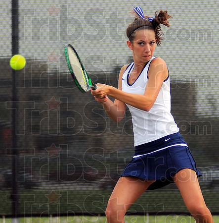 On target: Terre Haute North #1 doubles player Morgan Mills returns a shot.