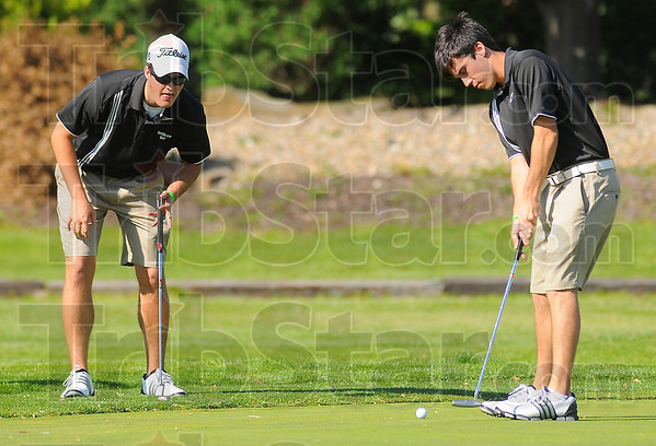Watching: Northview golfers Drew Snyder and Daniel Eaglin on the second green in the Knights match with Terre Haute North Thursday evening.