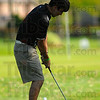 Shade shot: Knight golfer Daniel Eaglin chips to the third green in their match with Terre Haute North Thursday evening.