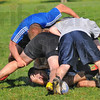 Protect yourself: Garrett Fredrick covers up at the bottom of a pile during a practice session of the ISU rugby club.