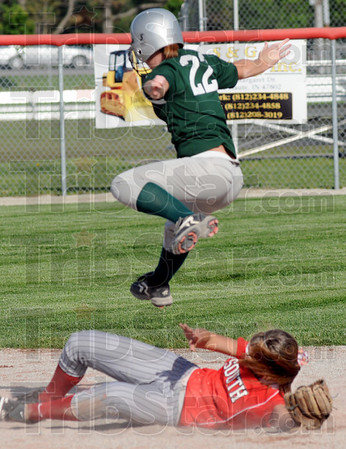 Up: North Central's #22, Katie Brown leaps over a falling South player to second base during game action Thursday afternoon. Brown was safe on the play.