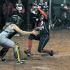 Score: North's #24, Carly Mundy scores during game action against Sullivan Thursday night. Sullivan catcher #2, Allexis Mahurin waits for the incoming ball.