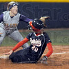 Safe: North's #20, Marlee Yeager slides into third base ahead of the ball during game action Thursday night. Sullivan's #14, Alisha Lowery fields the throw.