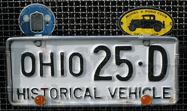 "Ford detail: A 1925 Ohio license plate adorns a Model ""A"" Ford in the Holiday Inn parking lot Thursday afternoon."