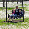 Spring break: Scott Bailey swings in Collett Park Sunday afternoon with his children Jacelyn and Jordan.
