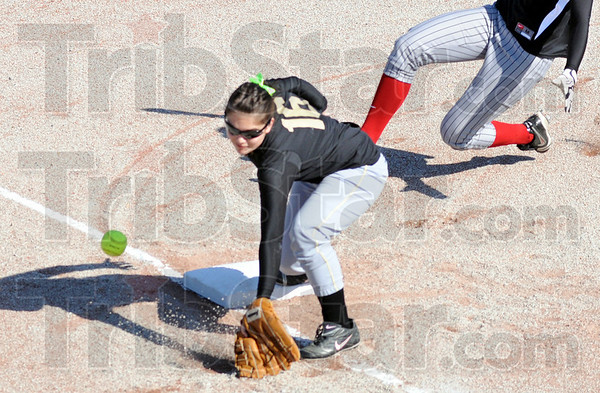 Wide: Union third baseman #16, Tori Martindale can't get to a wide throw from the catcher during Friday's game against Terre Haute South.