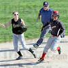 Headed for three: South's #30, Taylor Derickson rounds second, enroute to third base during a multi-run first inning for the Braves. Union shortstop #24, Conner Kendall  follows the action along with the base umpire.