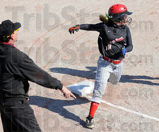 Stop right here: Terre Haute South coach Steve Woerner has Taylor Derickson stop as she rounds third base during<br /> game action against the Union-Dugger Bulldogs.