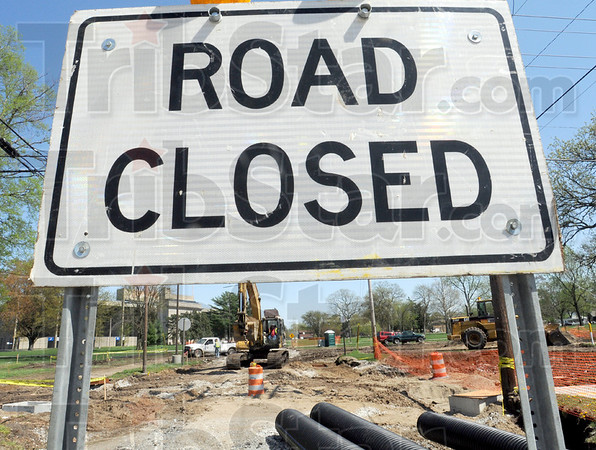 Construction: Construction crews work along Brown Avenue near Memorial Stadium Friday afternoon.