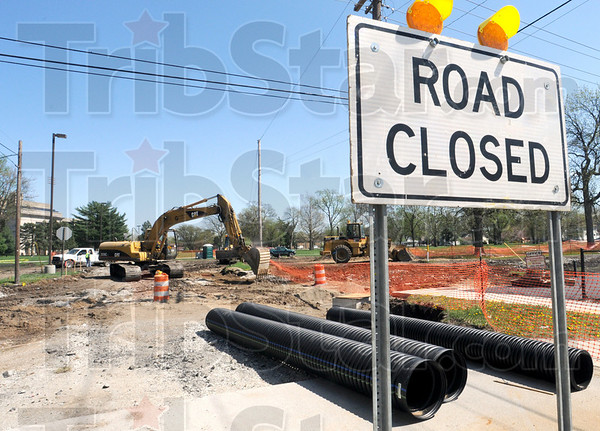Closed: Construction crews work on the Brown Avenue project Friday afternoon.