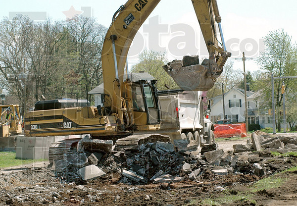 Big chunks: An excavator takes big bites of Brown Avenue near Wabash Avenue and puts it into a waiting truck Friday afternoon.