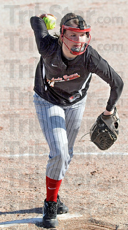 Windup: South's #21, Marissa Stout starts her pitching motion during game action against Union-Dugger Friday eveing in the first game of the Lady Braves Invitational.