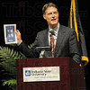 Bayh Family: Senator Evan Bayh holds a program with photographs of his family members during Friday's dedication ceremony at University Hall on the Indiana State University campus.