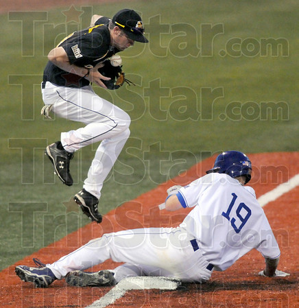 Safe: Indiana State's #19, Robby Ort makes it safely into third base during game action against Wichita State Friday evening at Bob Warn Field. Blocking the throw is third baseman #38, Erik Harbutz.