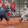 Not even close: Terre Haute North catcher Kelsey Coffey waits with the ball for Mooresville baserunner Hali Hopwood to reach her for the tag out at homeplate.