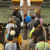 Veneration: The Catholic faithful show their faith at the Good Friday services at St. Joseph University Parish.