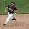 Inside the park home run: Terre Haute South's #22, Jacob Hayes heads for third base on his round tripper during Friday night game action.