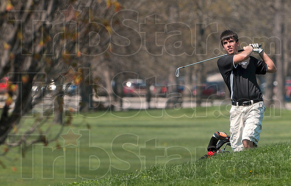 Tribune-Star/Joseph C. Garza<br /> On its way: Northview golfer Daniel Eaglin watches his drive fly towards the cup at Forest Park Saturday.