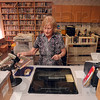 Tribune-Star/Joseph C. Garza<br /> Checking out: Palestine Public Library District Director, Sue Lockhart, checks out a book in the library's computer system Thursday in Palestine, Ill. Lockhart and her library patrons will soon enjoy a new building thanks to a generous contribution from the late Inez and Don Winter.