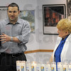 Thoughts: Student Rabbi Matt Cohen speaks with a small group in attendance at the Holocaust Remembrance Day candle lighting ceremony Saturday. Eva Kor listens at right.