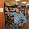 Tribune-Star/Joseph C. Garza<br /> Moving plans: Palestine Public Library District board member Jim Kincaid talks about the plans to move the books and their shelves during a tour of the old library in Palestine, Ill., Thursday.