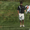 Tribune-Star/Joseph C. Garza<br /> In the lead: Terre Haute South's Thomas Goss tees off on one of the holes at Brazil's Forest Park Saturday as Northview's Daniel Eaglin looks on.