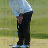 Tribune-Star/Joseph C. Garza<br /> Precision putt: Terre Haute South's Thomas Goss taps in a putt on the ninth hole at Forest Park in Brazil Saturday.