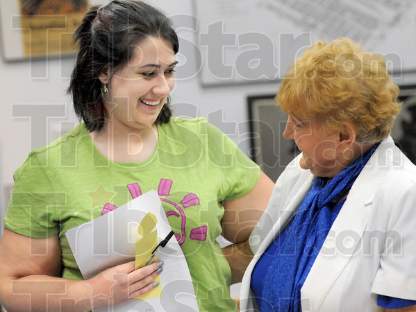 """Inspired: Indiana State University student Rebekah Dickey expresses her thanks to Eva Kor for """"inspiring me"""" during Saturday's Holocaust Remembrance Day event at the C.A.N.D.L.E.S. Museum."""