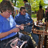 Value added work: Spinners Charlotte Black and Jackie Martin spin yarns at St. Mary-of-the-Woods Earth Day celebration Saturday afternoon. Black spins a combination of sheep wool, llama fibre and angora hair. Martin, of Absolutely Amazing Alpacas, spins her yarn from alpaca fibres.
