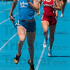 Tribune-Star/Joseph C. Garza<br /> No catching her: Indiana State's Erica Moore nears the finish line after she caught up to and passed her Indiana opponent in the final lap of the women's 4x400-meter relay Saturday during the Indiana State University Quadrangle at Marks Field.