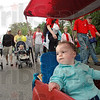 March for Babies: Eleven-month-old Lillian Berg enjoys the ride as she's being pulled along Brown Avenue at the start of the March For Children event Saturday morning.