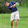 Bunker buster: North's Ryan Sneddon hits a shot from the bunker during early action of the South Invitational Saturday morning at Rea Park.