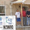 Getting close: Carlos Hernandez and his wife Mercedes Estremera stand with Habitat for Humanity foreman Pat Brown on the front porch of Estremera's home. The move-in date for the latest Habitat home is May 16th.