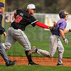 Run down feeling: Brave A.J. Reed tags New haven baserunner Trevor Waidelich out in a 7th inning rundown.