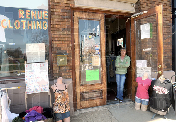 Petition: Juanita Parkhurst stands in the doorway of her 12 Points business Thursday afternoon. She's in favor of the repeal of an ordinance that will require her to make daily reports for police.