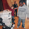 Tribune-Star/Joseph C. Garza<br /> Up close with Curby: Franklin Elementary School students, including second grader, Lashawan Tompkins, right, get a closer look at Curby the recycling robot after a presentation on recycling by TREES, Inc., Wednesday at the school.