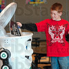 Tribune-Star/Joseph C. Garza<br /> Throw it away or recycle it?: Franklin Elementary School third grader, Gavin Nesbit, attempts to throw away a magazine but is reminded Curby the recycling robot that magazines and newspapers can be recycled Wednesday at the school.