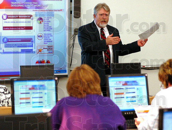 Services: Bob Stephenson, business services representative from Illinois Eastern Community Colleges teaches during a business seminar at Casey-Westfield High School.