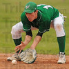 Two hands: Viking second baseman Zack Kent  fields a ground ball in their game with North Central Wednesday evening.