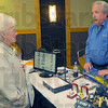 Sights and sounds: Elizabeth Effner listens to Jim Fostman of Vision Aid Systems. He sells several items to help the vision impaired including a device that will read printed pages and turn them into spoken words.