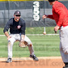 Hit and run: Rose-Hulman's B.J. Zobrist fields a hit ball as a baserunner attempts to advance during practice Wednesday afternoon.