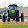 Straight and narrow: Tom Low drives his tractor planting a test plot of corn just off Highway 1 south of Marshall Wednesday afternoon.