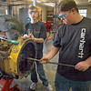 Technology: West Vigo automotive technology students Sean Hendricks and Gage Pritcher work on a tractor that will become an exhibit for the Children's Museum.