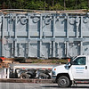 Tribune-Star/Joseph C. Garza<br /> Quite the load: Edwards Moving & Rigging employees are dwarfed by the Duke Energy transformer as it is stabilized for transportation along US 40 west of West Terre Haute Wednesday.