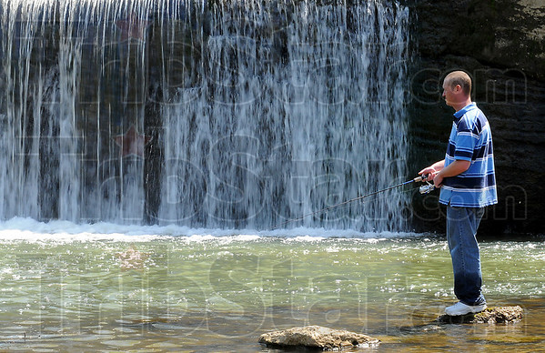Wetting a line: Jeff Welbourne tries to fool a fish at Markle Mill Park Wednesday afternoon.