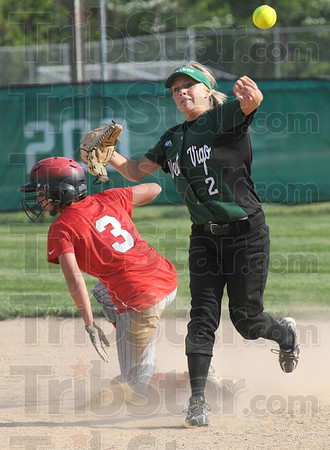 Forced: South's #3, Jena Renteria is forced out at second base during game action Wednesday afternoon. West Vigo's #2, second baseman Sam Richey fires the ball to first base to attempt the double play.