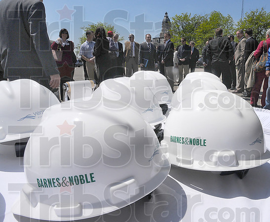 New beginnings: Labeled construction hats wait for dignataries to don them at the groundbreaking ceremony for the new Barnes & Noble Bookstore.