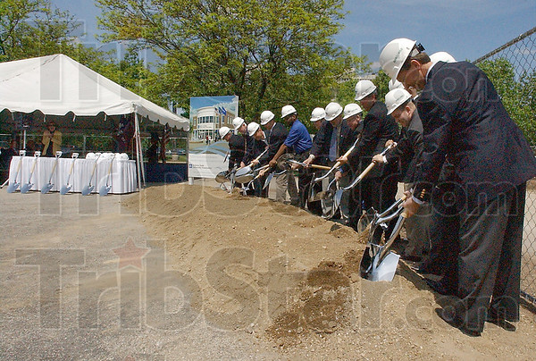Good turn: Dignataries from Indiana State University, the ISU Foundation and other organizations turn a symbolic shovelful of dirt, marking the start of construction on the Barnes & Noble Bookstore and offices for the ISU Foundation.